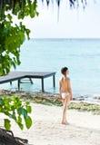 Asian girl in bikini standing on beach Royalty Free Stock Photos