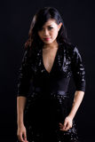 Asian girl in black cocktail dress. Beautiful asian girl in a glittering black cocktail dress stock images