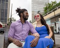 Asian girl and black man dating and having fun in the street. Multiethnic brazilian couple. Japanese women and black men dating and having fun in the street royalty free stock photo