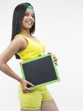 Asian girl with a black slate Royalty Free Stock Images