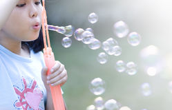 Asian girl blow soap bubble Stock Photo
