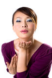 Asian Girl blowing kiss. Beautiful Asian woman in purple dress giving blowing kisses Royalty Free Stock Photos