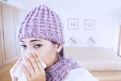 Asian girl blowing nose wearing beany in winter Stock Photo