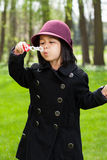 Asian girl blowing soap bubbles Royalty Free Stock Images