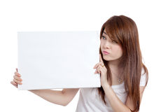 Asian girl bore look at  blank sign Royalty Free Stock Photo