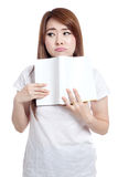 Asian girl bore reading book Stock Photo