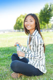 Asian girl with a bottle of water Royalty Free Stock Image