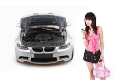 Asian girl with breakdown car. Asian girl is calling for help on her breakdown car Stock Photo