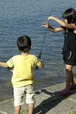 Asian girl and brother fishing Royalty Free Stock Images