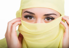 Asian girl with brown eyes posing in a yellow scarf, muslimah model in hijab isolated in white background Stock Images