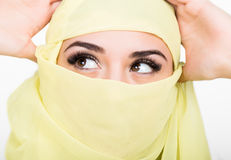 Asian girl with brown eyes posing in a yellow scarf, muslimah model in hijab isolated in white background Stock Photos