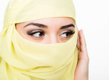Asian girl with brown eyes posing in a yellow scarf, muslimah model in hijab isolated in white background Stock Photo
