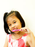 Asian girl brushing her teeth Royalty Free Stock Photo