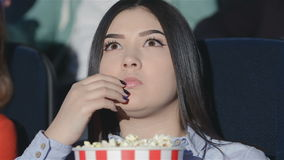 Asian girl with a bucket of popcorn stock video