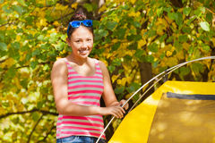 Asian girl build yellow tent herself during day Stock Photos