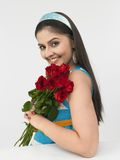 Asian girl with a bunch of roses Stock Photos