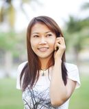 Asian girl calling with mobile phone Stock Photography