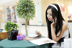 Asian girl calling by phone. Royalty Free Stock Photography