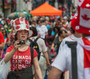 Asian Girl with Camera on Canada Day Stock Image