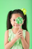 Asian girl with candy Royalty Free Stock Image
