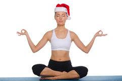 Asian girl in a cap of Santa Claus Royalty Free Stock Images