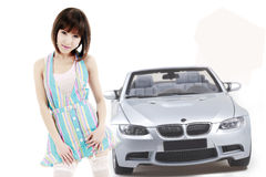 Asian girl with car Royalty Free Stock Images