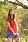 Asian girl with carefree concept. She enjoys the atmosphere of nature and feels very relax Royalty Free Stock Images