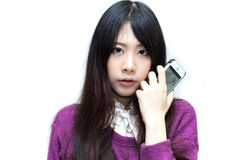 Asian girl in casual wear playing moblie phone Stock Photography