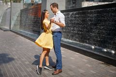 Asian girl and caucasian man together dancing on the street royalty free stock photography