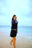 Asian girl with cell phone Royalty Free Stock Photos