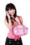 Asian girl on cell phone. Royalty Free Stock Image