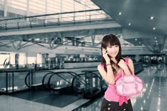 Asian girl on cell phone. Royalty Free Stock Photography