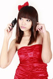 Asian girl with cellphone Stock Photography