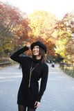 Asian girl in Central Park. Fashion model poses in Central Park New York.  She was 23 at the time of shoot and of Japanese ethnicity.  Photographed November Stock Photos