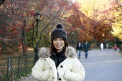 Asian girl in Central Park. Fashion model poses in Central Park New York.  She was 23 at the time of shoot and of Japanese ethnicity.  Photographed November Royalty Free Stock Images