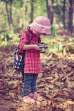 Asian girl checking photos in digital camera. Vintage picture st Royalty Free Stock Photography