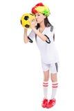 Asian girl cheerleader, chinese. Beautiful cheerleader yellow soccer ball on a white background Stock Photo
