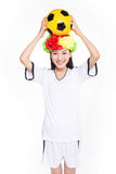 Asian girl cheerleader, chinese. Beautiful cheerleader yellow soccer ball on a white background Royalty Free Stock Photography