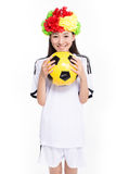 Asian girl cheerleader, chinese. Beautiful cheerleader yellow soccer ball on a white background Stock Photos