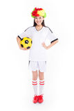Asian girl cheerleader, chinese. Beautiful cheerleader yellow soccer ball on a white background Royalty Free Stock Photo