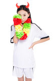 Asian girl cheerleader, chinese. Happy cheerleader holding pom-pom, white background Royalty Free Stock Photos