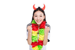 Asian girl cheerleader, chinese. Happy cheerleader holding pom-pom, white background Royalty Free Stock Photo