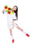 Asian girl cheerleader, chinese. Happy cheerleader holding pom-pom, white background Stock Photography
