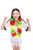 Asian girl cheerleader, chinese. Happy cheerleader holding pom-pom, white background Stock Images