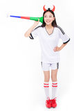 Asian girl cheerleader, chinese. Uniformed cheerleader a pose with a megaphone isolated on white Royalty Free Stock Photo