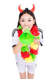 Asian girl cheerleader, chinese. Uniformed cheerleader a pose with a megaphone isolated on white Stock Images