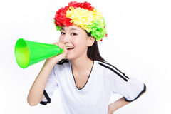 Asian girl cheerleader, chinese. Uniformed cheerleader a pose with a megaphone isolated on white Stock Photography
