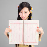Asian girl in  cheongsam qipao with chinese book Stock Photo