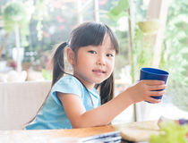 Asian girl child drink some water Stock Photo