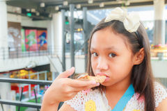 Asian girl child eat pizza Stock Image
